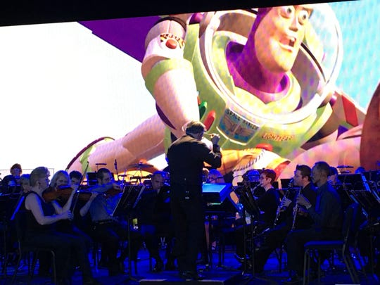 """The Music of Pixar"" concert, performed nightly at Disney's Hollywood Studios, is led by Brevard Symphony Orchestra's maestro Christopher Confessore. ""The Music of Pixar"" concert, performed nightly at Disney's Hollywood Studios, is led by Brevard Symphony Orchestra's maestro Christopher Confessore."