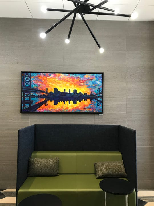 "The lobby and other common areas at 11 Cooper feature artwork by local artists, including ""Flourish,"" a painting by Camden artist William Butler."