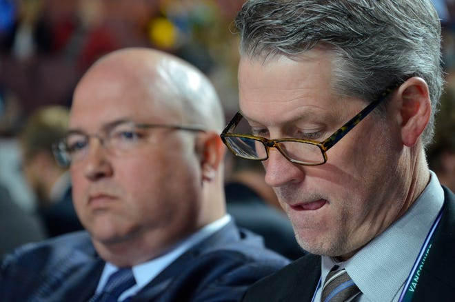 Flyers assistant general manager Brent Flahr, left, and general manager Chuck Fletcher, right, have more than the NHL roster to consider with trade deadline plans.