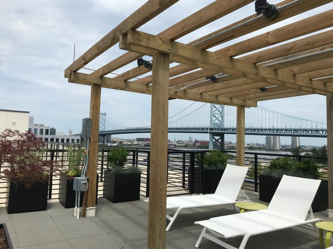 The rooftop deck at 11 Cooper has seating areas, a hot tub and panoramic views of the city, the Delaware River, Ben Franklin Bridge and Philadelphia skyline.