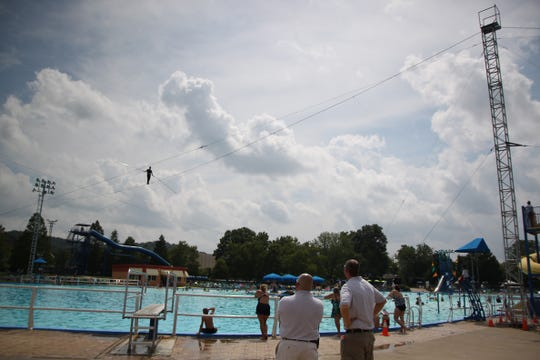 In 2010, Nik Wallenda walked across a wire suspended five stories above the Sunlite Pool at Coney Island in Cincinnati. Guests don't need to go to such extremes to experience the water park, which will be the focus when Coney Island shuts down all its rides.