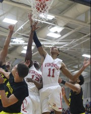 Princeton's Darius  Bazley and Darrion Henry battle for  a rebound during the Viking's Flyin' to the Hoop Game against Wheeler, Monday, Jan. 16,2017.