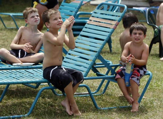 Ryan Totten (front), 6, of West Chester,  watches Nik and Erendira Wallenda perform on swaypoles with other observers, tall poles that sway in the air, at Coney Island, the afternoon of June 28, 2010.
