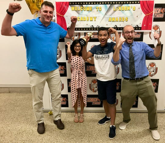 "School No. 9 students won the award for Best Elementary School Project Grades 4-5 at the Linden Public Schools Academy Awards for a video called ""Robo Gym."" Pictured are physical education teacher Brian Marcus, students Juliana Aristizabal and Vincent Vega, and technology teacher Mitch Gorbunoff."