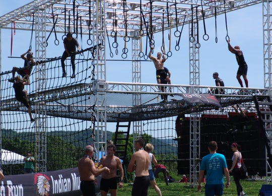 Competitors tackle the floating walls at the 2019 Indian Mud Run.