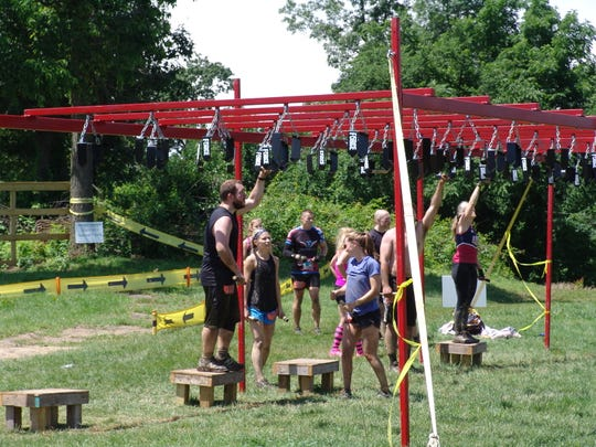 Race officals estimate more than 1000 participants took on the 8th Indian Mud Run in Coshocton on Saturday.
