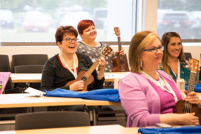A group called Little Kids Rock taught ukulele lessons during the Iowa Fine Arts Education Summit on June 20 at the Des Moines Area Community College in Ankeny.