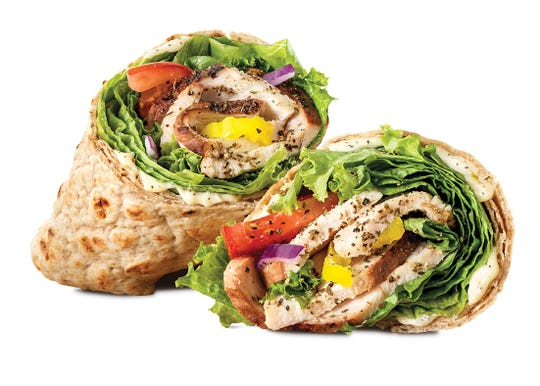 Arby's Creamy Mediterranean Wrap - Seasoned, carved slow-roasted chicken breast with creamy tzatziki sauce, banana peppers, green leaf lettuce, tomato, and red onion in a whole wheat wrap