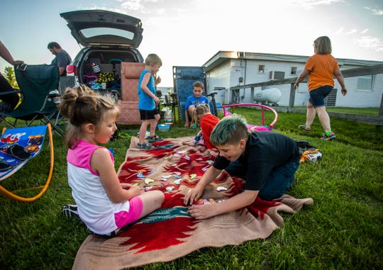 Children play a game at the 61 Drive-In Theatre in Delmar, Iowa, near Maquoketa, on Saturday, June 8, 2019.