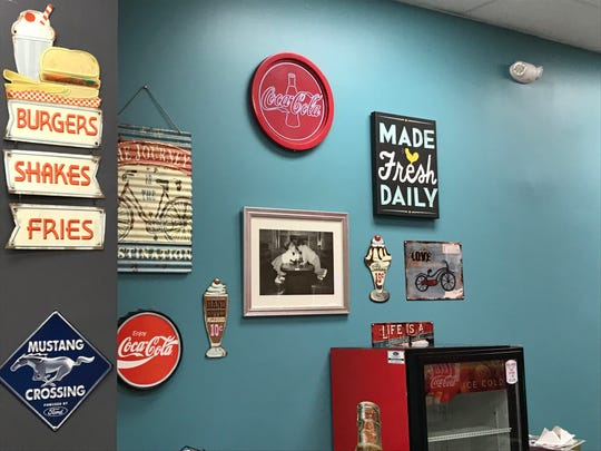 Classic memorabilia lines one of the walls inside Sugar Shack in Altoona. The restaurant, which closed in October, is expected to open in its new location along 36th Avenue Southwest on Monday.
