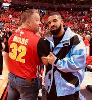Frank Molak poses with the rapper Drake while wearing Nick Nurse's Kuemper Catholic high school basketball jersey on the sidelines of Game 5 of the NBA Finals in Scotiabank Arena in Toronto on June 10, 2019.