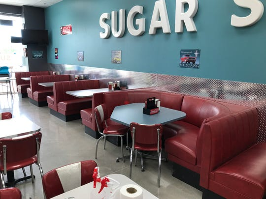 Letters from one of the old Sugar Shack signs are now fixed to the walls in the dining area of the restaurant's new Altoona location. The restaurant is expected to reopen Monday, July 1.