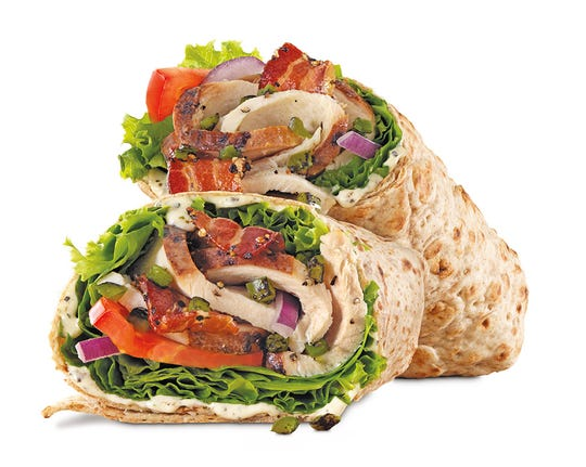 Jalapeño Bacon Ranch Chicken Wrap - Carved slow roasted chicken breast with pepper bacon, fire-roasted jalapenos, Parmesan peppercorn ranch sauce, green leaf lettuce, tomato, and red onion in a whole wheat wrap