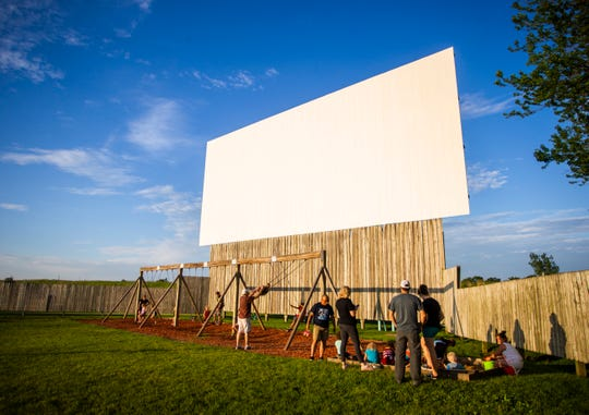 Children play at the 61 Drive-In Theatre in Delmar, Iowa, near Maquoketa, on Saturday, June 8, 2019.