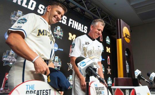 Michigan coach Erik Bakich and Vanderbilt coach Tim Corbin share a laugh on Sunday, June 23, 2019, in Omaha, Nebraska.