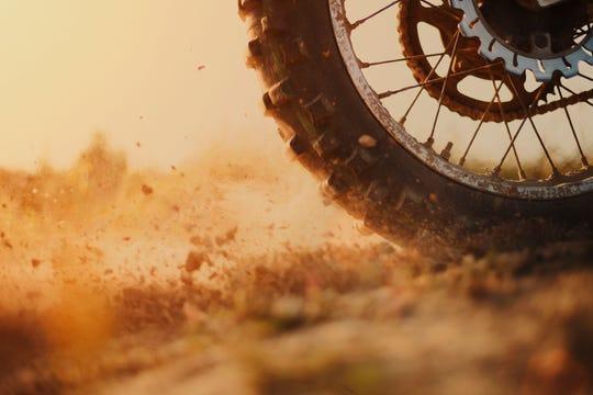 Rear wheel of bike digging the dirt.