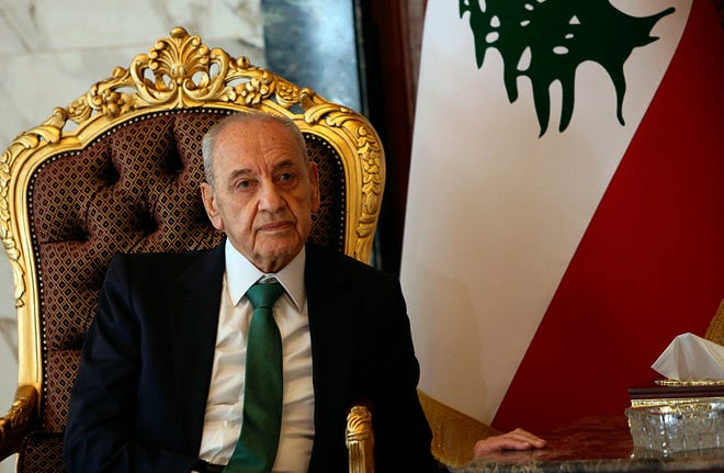 In this March 31, 2019, file photo Nabih Berri, speaker of the Lebanese parliament, meets with Deputy Speaker of the Iraqi Parliament Hassan Karim, in Baghdad, Iraq.