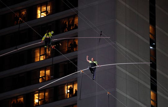 Aerialists and siblings  Nik Wallenda, right, and Lijana Wallenda walk on a high wire above Times Square, Sunday, June 23, 2019, in New York.