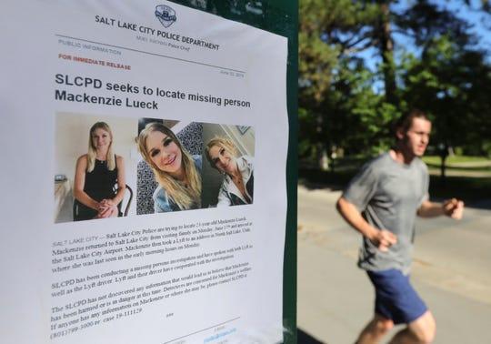 A joggers runs pass a poster of MacKenzie Luek at Liberty Park Monday, June 24, 2019, in Salt Lake City.