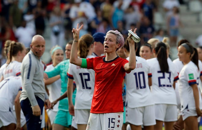 Megan Rapinoe of the United States celebrates at the end of the Women's World Cup round of 16 soccer match between Spain and the U.S. Rapinoe scored twice in her team's 2-1 victory.