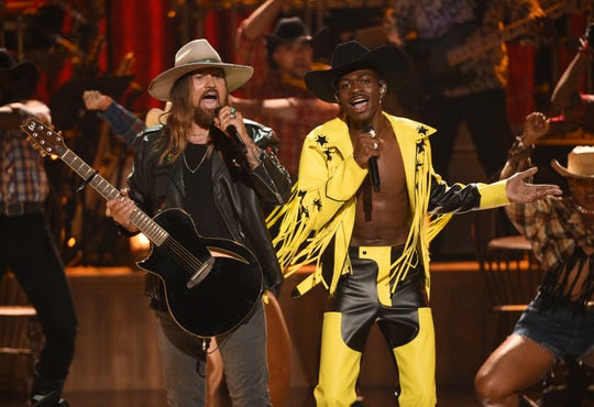 "Billy Ray Cyrus, left, and Lil Nas X perform ""Old Town Road"" at the BET Awards on Sunday, June 23, 2019, at the Microsoft Theater in Los Angeles."