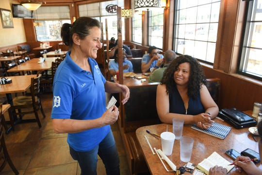 Lisa Dedvukaj, left, of Noni's Sherwood Grille, and Lauren Rivers, a realtor with Rivers Realty Group, hope the inaugural Rocket Mortgage Classic golf tournament will bring positive attention to the area.
