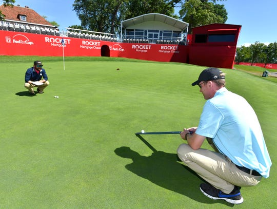 Detroit Golf Club assistant superintendent Adam LaFrance, left, of St. Clair Shores, and TPC Sawgrass assistant superintendent Kevin Kouba, right, of Ponte Vedra Beach, Fla., measure green speed to determine what maintenance, if any, is needed on the 18th green.