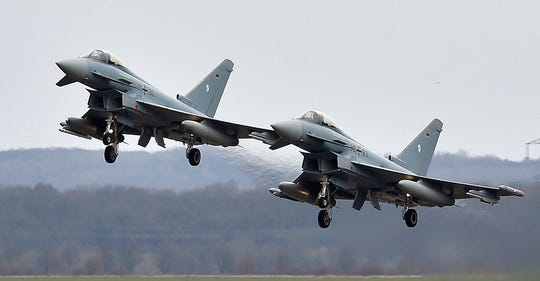 In this March 21, 2016 file photo, two Eurofighter jets perform at the German Air Force Base in Noervenich, western Germany. Two German Eurofighter military planes crashed today near the city of Jabel in eastern Germany.