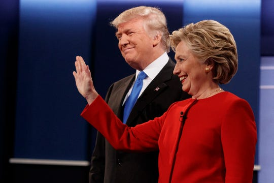 Then Republican presidential candidate Donald Trump, left, stands with then Democratic presidential candidate Hillary Clinton before the first presidential debate Sept. 26, 2016, at Hofstra University in Hempstead, N.Y.