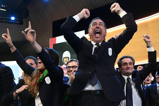 Mayor of Milan Giuseppe Sala and members of Milan-Cortina delegation celebrate after winning the bid to host the 2026 Winter Olympic Games.