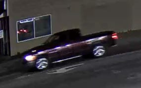 Detroit police say two men jumped out of this truck Friday night and assaulted a man at Plainview and West Warren avenues. One of the suspects was arrested; the other still is at large, police said.