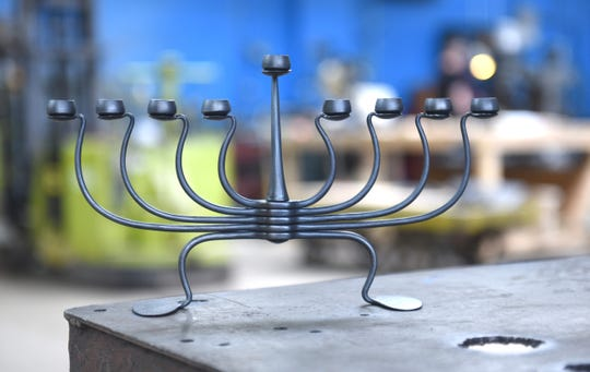 A steel menorah is one of the many items created at the Smith Shop in Highland Park.