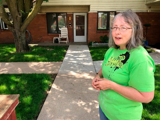 In this June 14, 2019 photo, Marti Poll, 55, discusses her struggle to get health care for a variety of conditions outside her apartment complex outside of Lincoln, Nebraska.