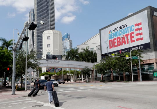 A billboard advertises the Democratic Presidential Debates across from the Knight Concert Hall at the Adrienne Arsht Center for the Performing Arts of Miami-Dade County, Monday.