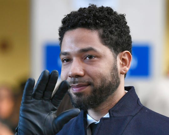 Actor Jussie Smollett waves to supporters before leaving Cook County Court after his charges were dropped March 26 in Chicago.
