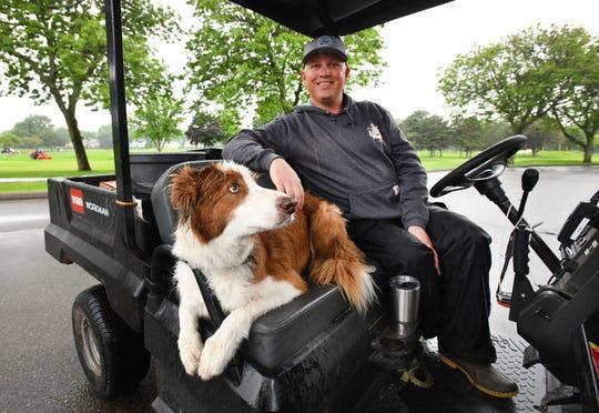 Detroit Golf Club superintendent Jake Mendoza with sidekick Sam.