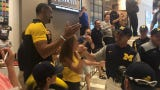 Michigan baseball team sendoff from its hotel before Game 1 of the College World Series