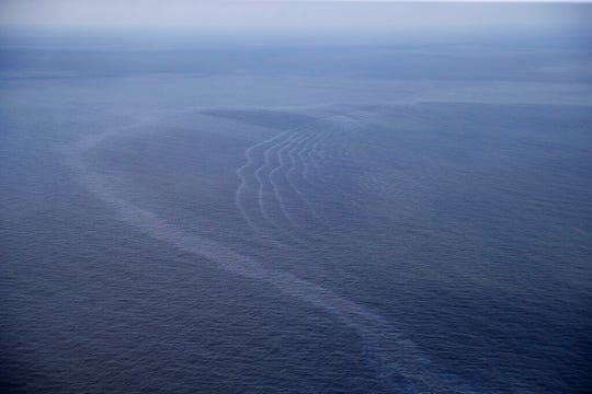 This March 31, 2015, aerial file photo, shows an oil sheen drifting from the site of the former Taylor Energy oil rig in the Gulf of Mexico, off the coast of Louisiana.