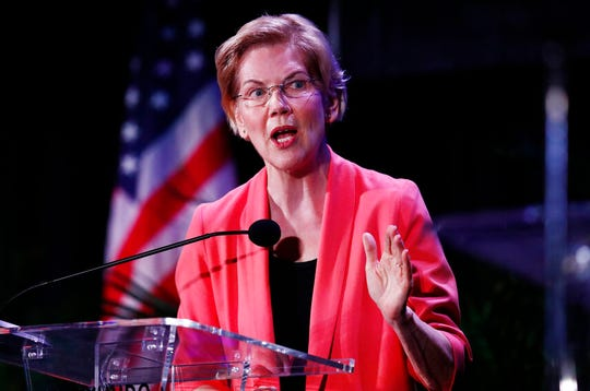 U.S. Sen. Elizabeth Warren, D-Mass., speaks during a forum on Friday, June 21, 2019, in Miami. Democratic presidential candidates Warren, shown, Pete Buttigieg and Beto O'Rourke support the idea of a moderate wealth tax on the fortunes of the richest one-tenth of the richest 1% of Americans.