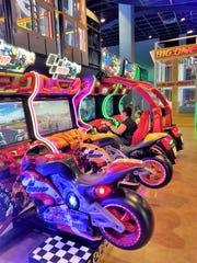 Patrons at the Newburgh Showplace Cinemas Family Entertainment Center enjoy video games on June 14, 2019.