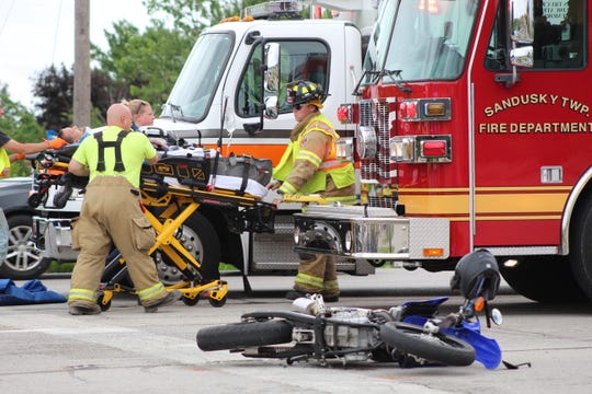 A Fremont man is taken by ambulance Monday after a woman crashed her vehicle into his motorcycle.