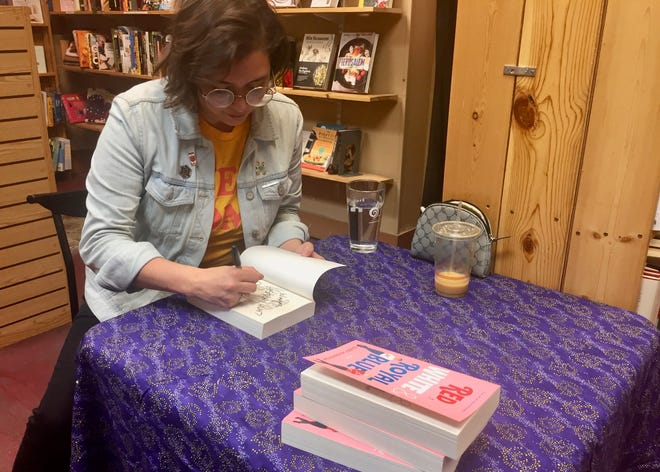 """Casey McQuiston signs copies of """"Red, White and Royal Blue"""" at Old Firehouse books in Fort Collins."""