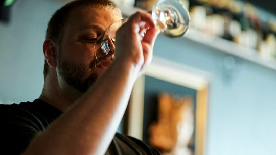 Ryan Lay takes a sip of wine as he talks about how to enjoy wine. Palace Pub & Wine Bar opened recently in Cape Coral. Its owners are young and they want to spread their love of wine to the craft-beer crowds.