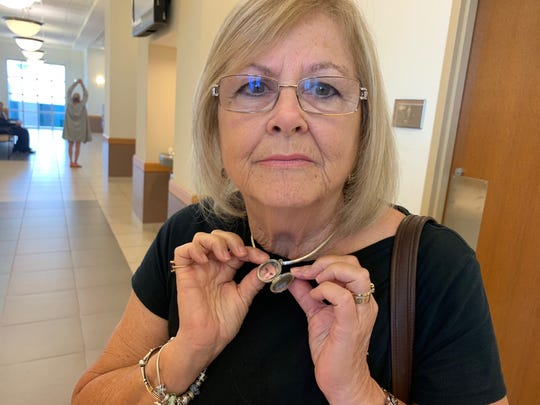 Barbara Aiken, grandmother to eight-year-old Layla Aiken, who was killed in a hit-and-run crash March 25, shows the pendant she wears to remember her granddaughter.