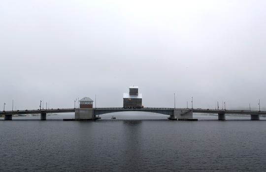 The 1901 Teweles and Brandeis Granary crosses the Oregon Street Bridge as fog rolls in over Sturgeon Bay on Monday, June 24.