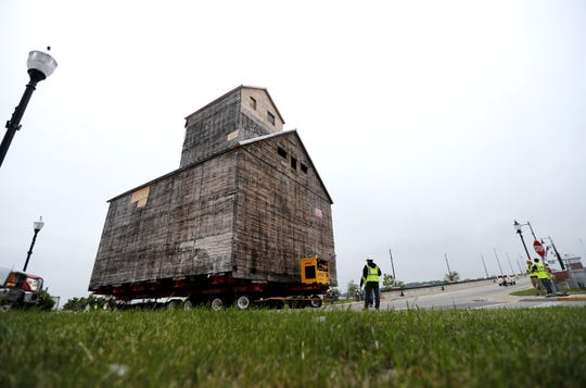 The 1901 Teweles and Brandeis Granary slowly makes a turn as it is moved onto the Oregon Street Bridge Monday, June 24, in Sturgeon Bay.