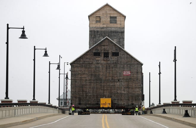The 1901 Teweles and Brandeis Granary crosses the Oregon Street Bridge Monday, June 24, 2019 in Sturgeon Bay.