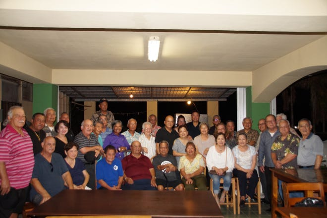 The Guam Class of 1964 gathered for a BBQ on May 25. Pictured sitting from left: Tom Vasapolli, Faye Vasapolli, Ralph Blas, Sebastian Leon Guerrero,  Kin Alicto, Maria Bunn,  Lou Paulino, Carrie Duenas. Second row: Bill Payne, Nick Francisco, Lauren Duenas, John Cruz, David Damian, Trudy Plummer, John Illarmo, Cathy Illarmo, John and Chilang Flores, Bobbie Santos, Mertile Quidachay, Bill Castro, David Matanane, Frank Pangelinan. Third row: Kin Perez, Charles Quinata, Frank Mendiola, John  T. Quichocho, Pete Paulino, Scott Duenas. Back row: Joe Quidachay, Joe San Nicolas,  Rick Agustin, Connie and Vic Reyes, John Santos and Weslie Bunn.
