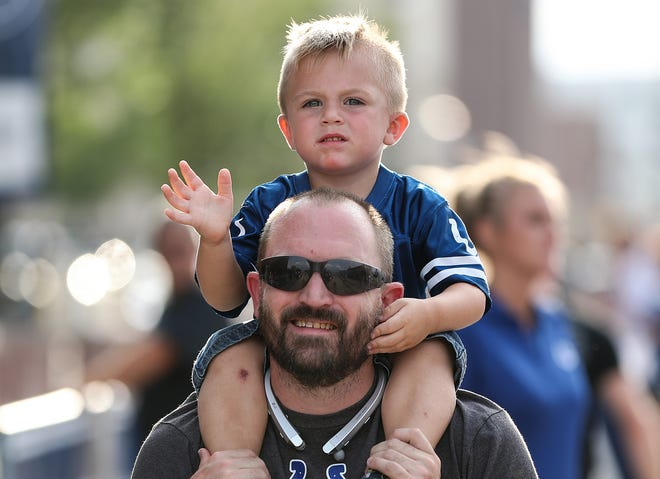 Indianapolis Colts fans enjoy the Fan Zone on South Street before the Colts' preseason game against the Baltimore Ravens at Lucas Oil Stadium in Indianapolis, Monday, Aug. 20, 2018.