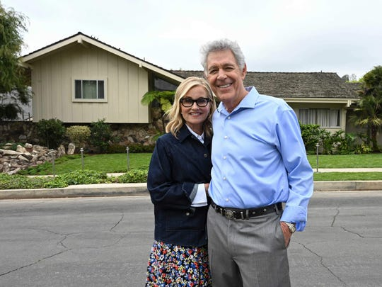 """""""The Brady Bunch"""" cast members Maureen McCormick and Barry Williams stand across the street from the home that served as the exterior for the sitcom that aired on ABC from 1969 to 1974."""